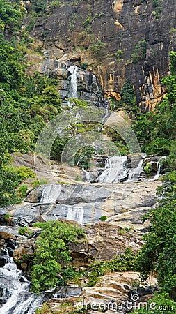 Waterfall cascading down mountainside