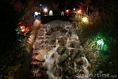 A waterfall on a minuature golf course at night