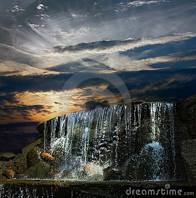 Waterfall at night at sunset