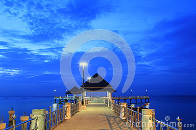 Waterfront pavilion with blue sky.