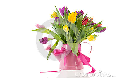 Watering can with bouquet tulips for birthday