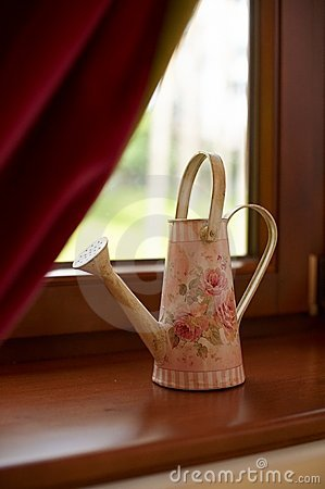 Watering can by window