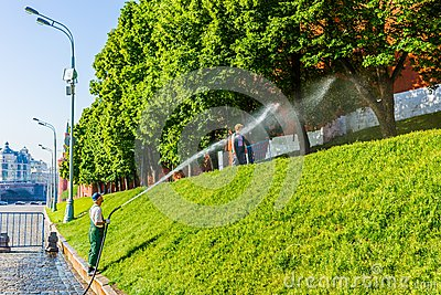 Watering the lawn by the Moscow Kremlin wall Editorial Photography