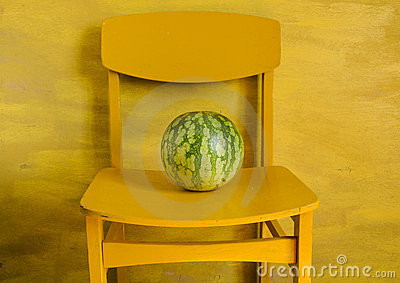 Watermelon on yellow chair