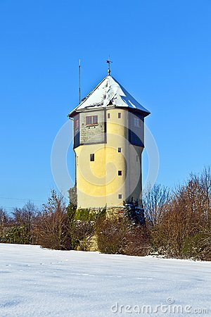 Watertower in  snow covered fields