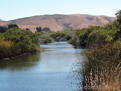 Waterway slough with hills
