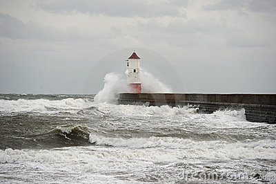 Wave breaking over lighthouse, Berwick upon Tweed