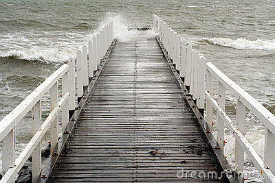Wave crashes along a jetty