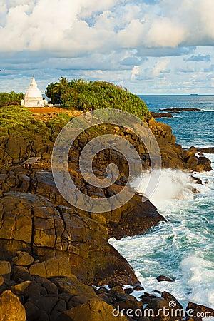 Free Wave Crashing Over Rock Headland Dagoba Unawatuna Stock Image - 27687681