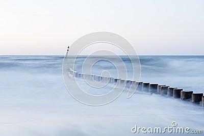 Wave flows around wooden breakwater