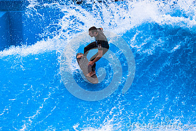 Wave Pool Action Surfer Carving Editorial Photo