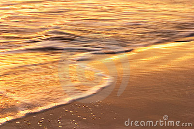 Wave and Sand at Sunset