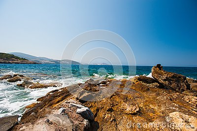 The waves beat on the rocks, the sea rages on the stones Stock Photo