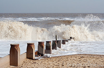 Waves breaking against groyne