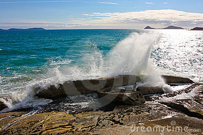 Waves breaking on rock