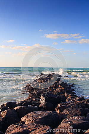 Waves breaking on rocky beach