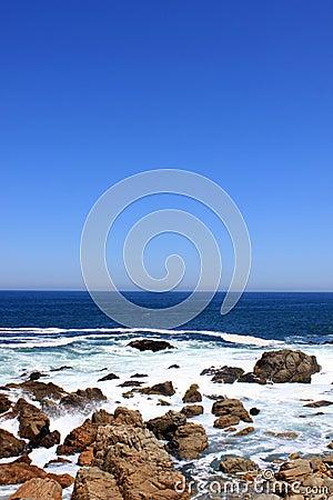 Waves breaking on rocky coast