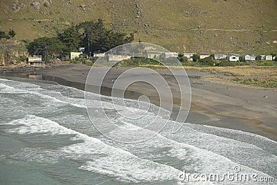 Waves breaking on sandy beach