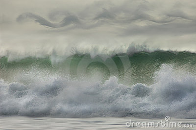 Waves breaking on the shore.