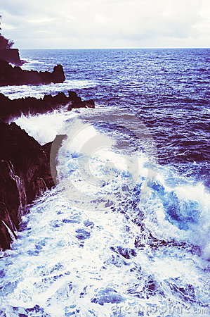 Waves Crash Into Rocky Shoreline