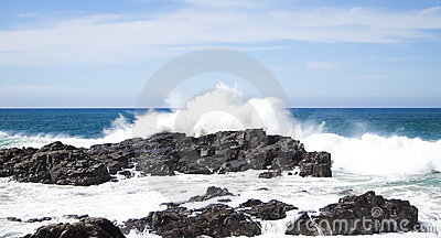 Waves crashing over rocks