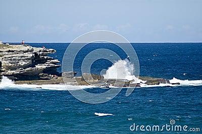 Waves crashing on rocks near bondi beach australia