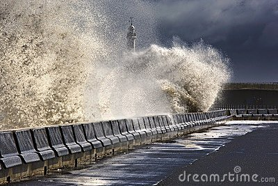 Waves Crushing Against Barrier