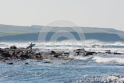 Waves at Lehinch and surfer