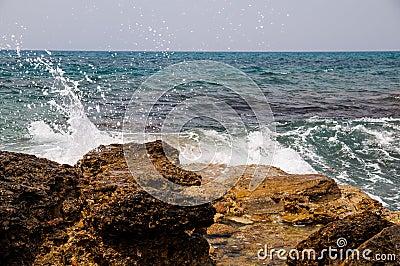 Waves on rock