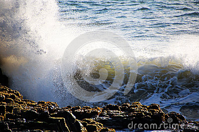 Waves Splashing on Basalt Rocks