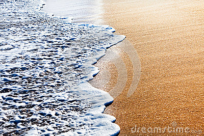 Waves splashing on sandy beach