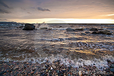 Waves wash ashore at sunset