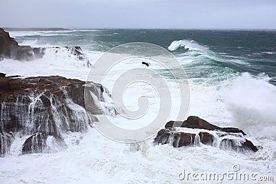 Sea storm at rocky coast
