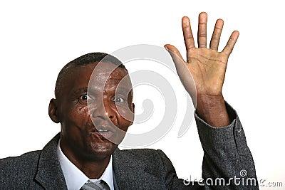 Waving African businessman