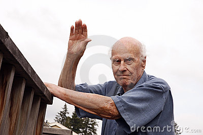 Waving Senior Neighbor Outdoors