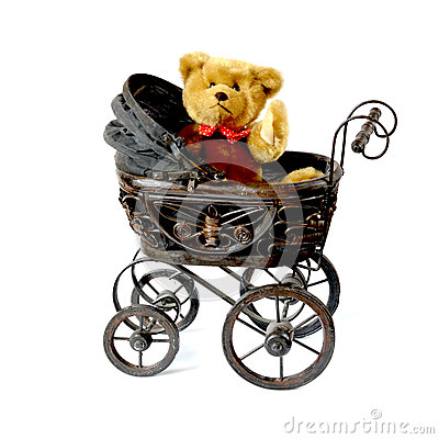 Waving teddy bear in vintage pram