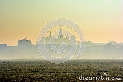 Wawel Castle in the morning fog or smog, Krakow