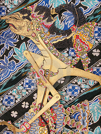 Free Wayang Kulit Puppet On Batik Royalty Free Stock Photos - 5871268