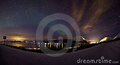 Weak aurora northern light over the winter sea