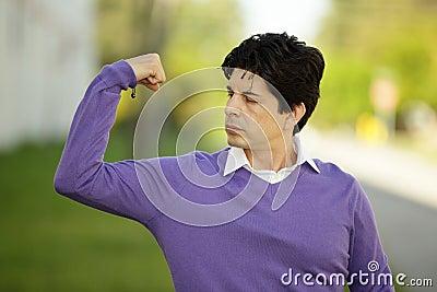 Weak man flexing his muscles