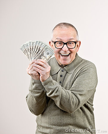 Wealthy man holding group of twenty dollar bill
