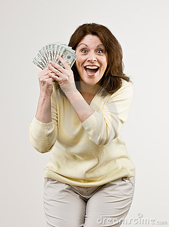 Wealthy woman holding group of twenty dollar bi