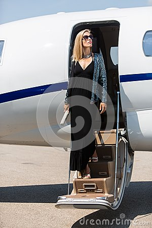 Wealthy Woman Stepping Out Of Private Jet