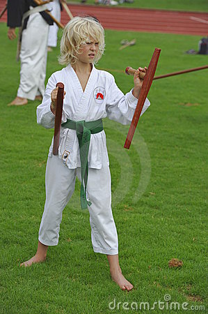 Weapon Karate with Tonfa Editorial Image