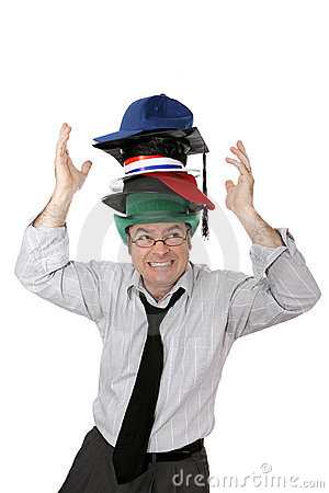 Free Wearing Too Many Hats Stock Photography - 3292412
