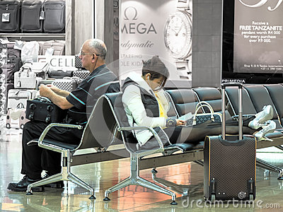 Weary Travelers Waiting At The Airport Editorial Photo - Image ...