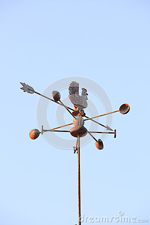 Free Weather Vane Compass Over House Roof Against Blue Sky Background Royalty Free Stock Image - 36739846