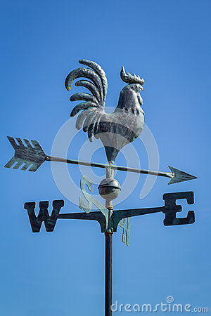 Free Weather Vane Showing Direction Of Wind Against Clear Blue Sky, Vertical Stock Image - 95780021