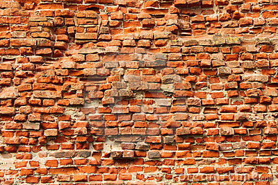 The weathered brick wall