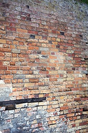 Weathered brick wall background, home related